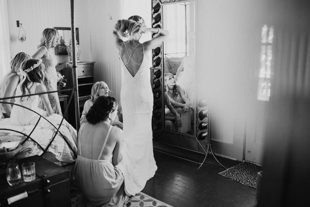 a bride dresses in a beaded slip dress at olowalu plantation house maui