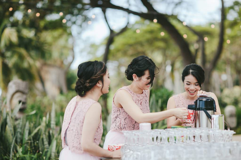 bridesmaids assist with tea ceremony at olowalu plantation house