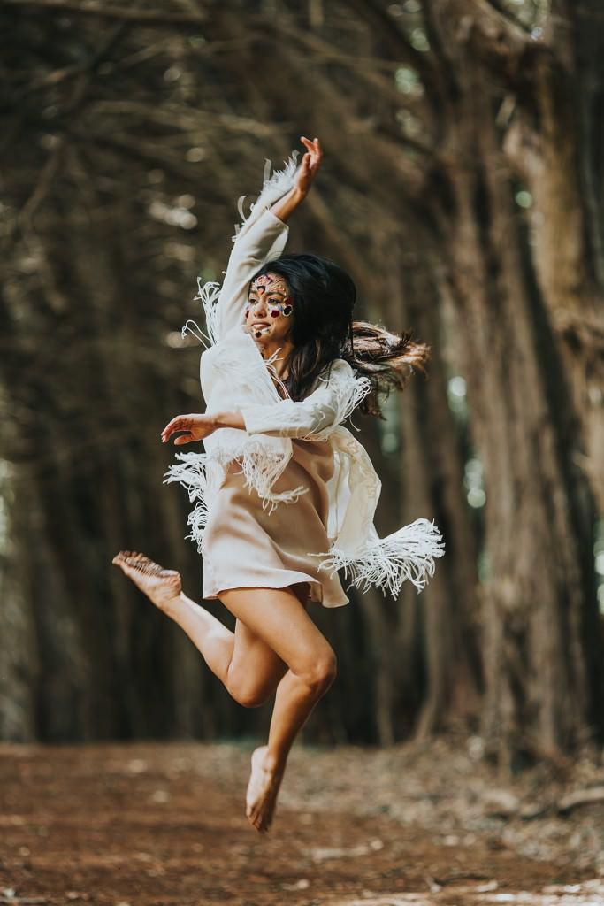 Hawaiian dancer in the forest leaping www.melialucida.com