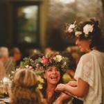 women wear floral crowns at Lumeria celebrating spring feast www.melialucida.com