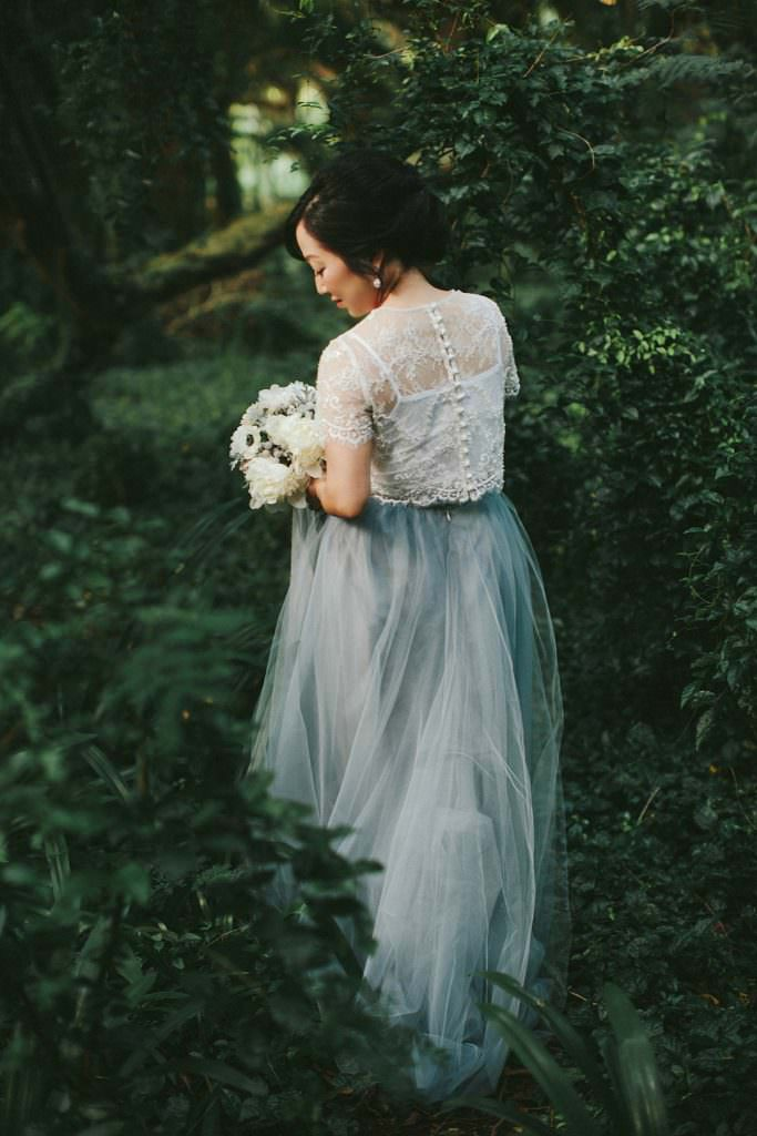 blue two-piece and lace wedding dress www.melialucida.com #hawaii #weddingphotos