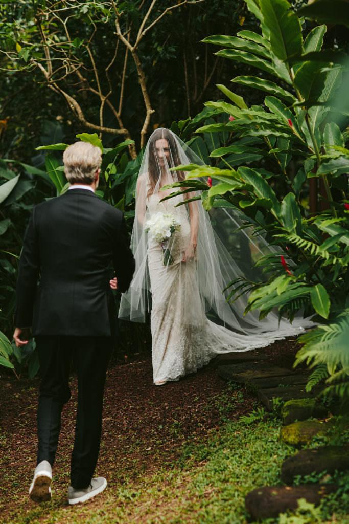a bride walks to her groom for her wedding ceremony near Waipio Valley Hawaii