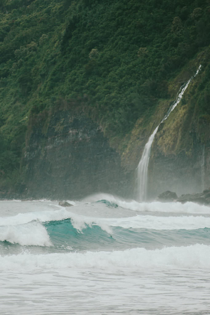 a waterfall flanking Waipio Valley