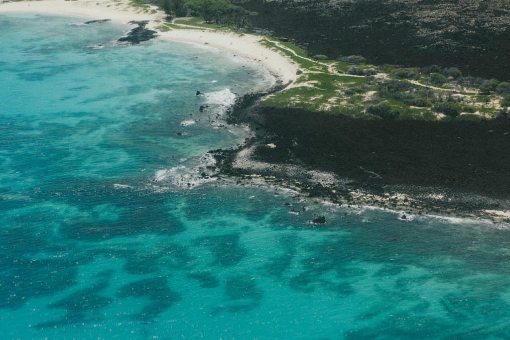 blue ocean and black lava coast line of Hawaii