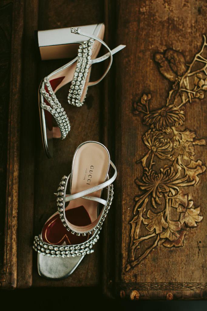 Gucci silver heels at a Hawaiian wedding