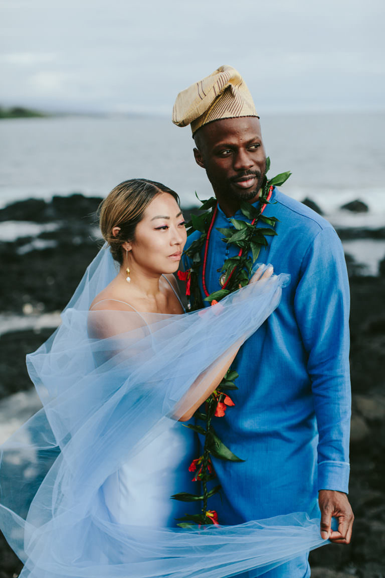 a multicultural bride and groom dressed in Blue in Hawaii
