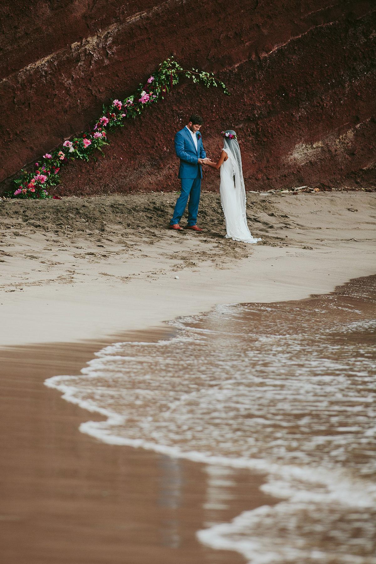 a couple elope on Koki beach Hana, Maui