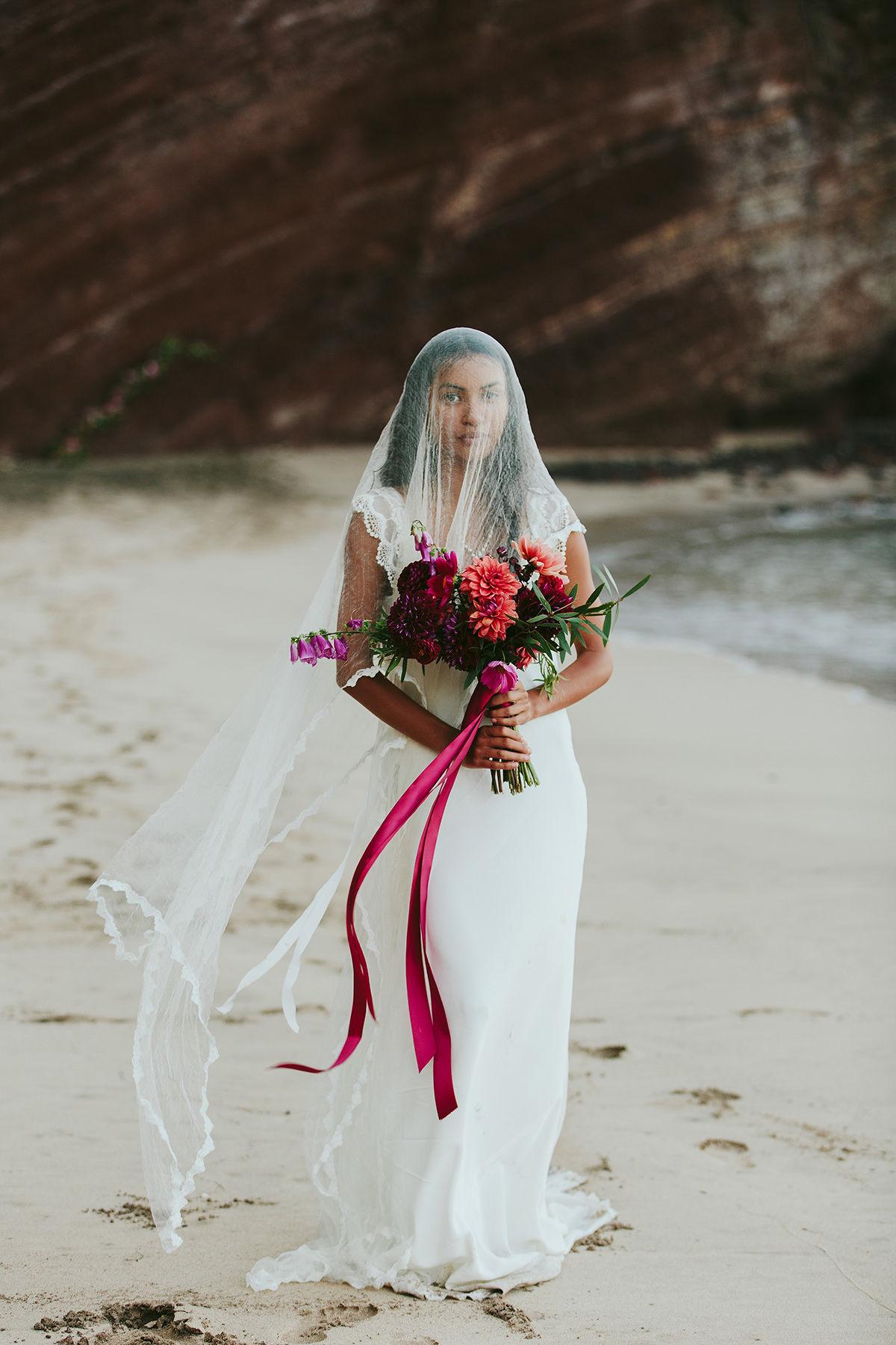 a veiled bride on Koki beach Maui