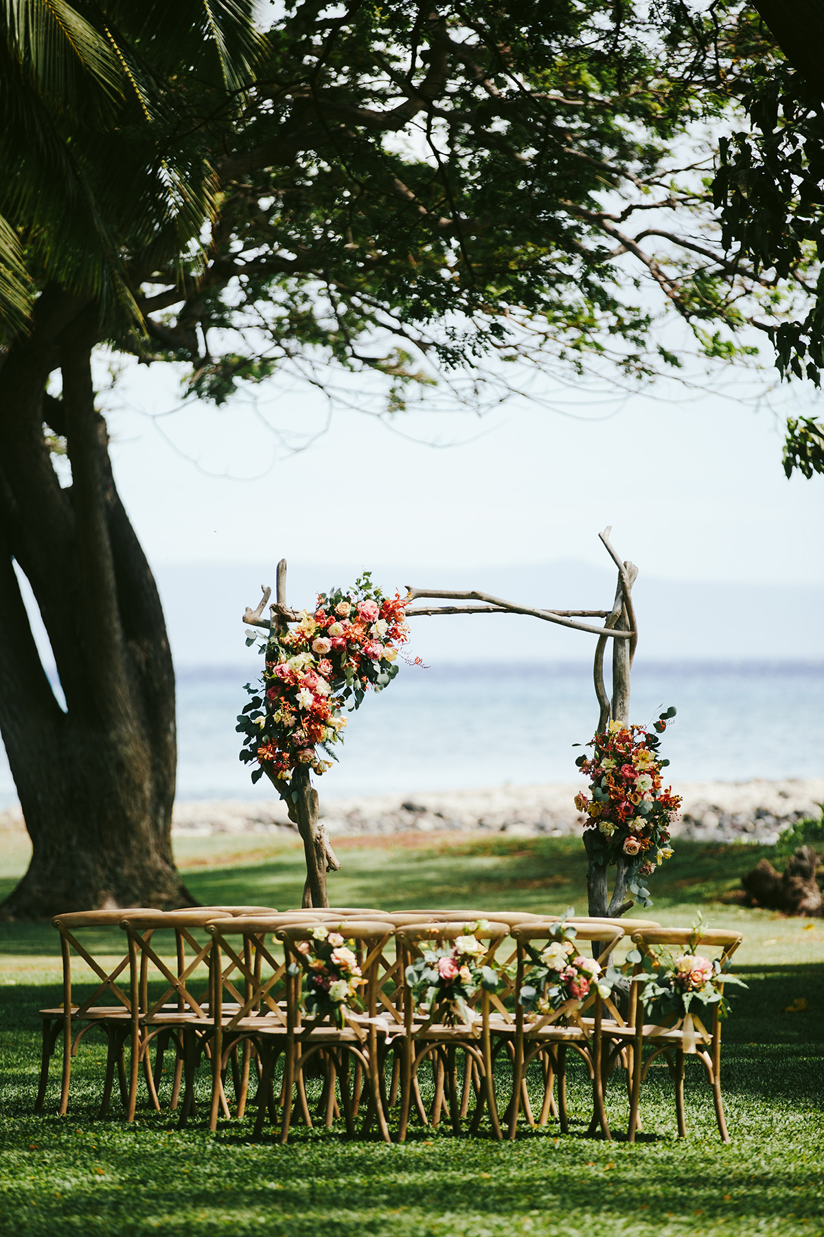 wedding chairs and floral arch at olowalu plantation house Maui