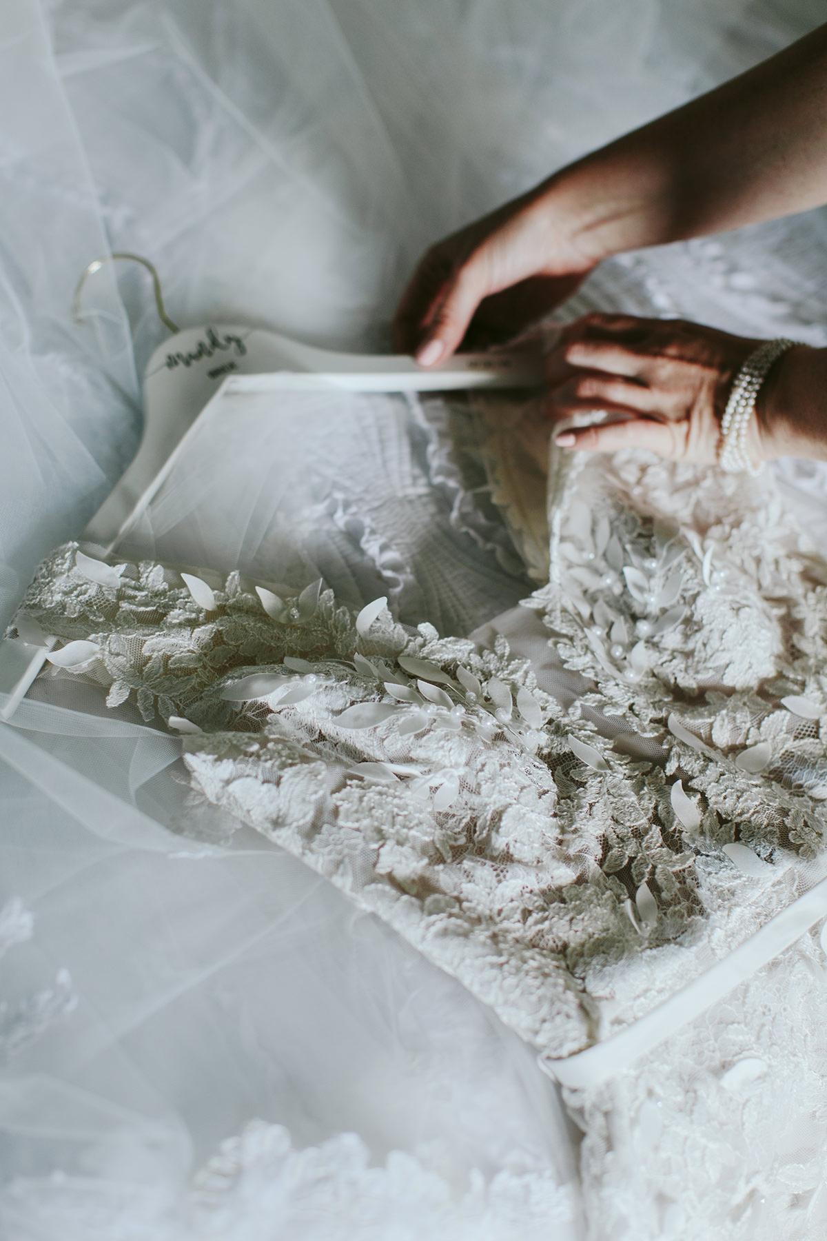 detail of Mira Zwillinger wedding dress on hanger
