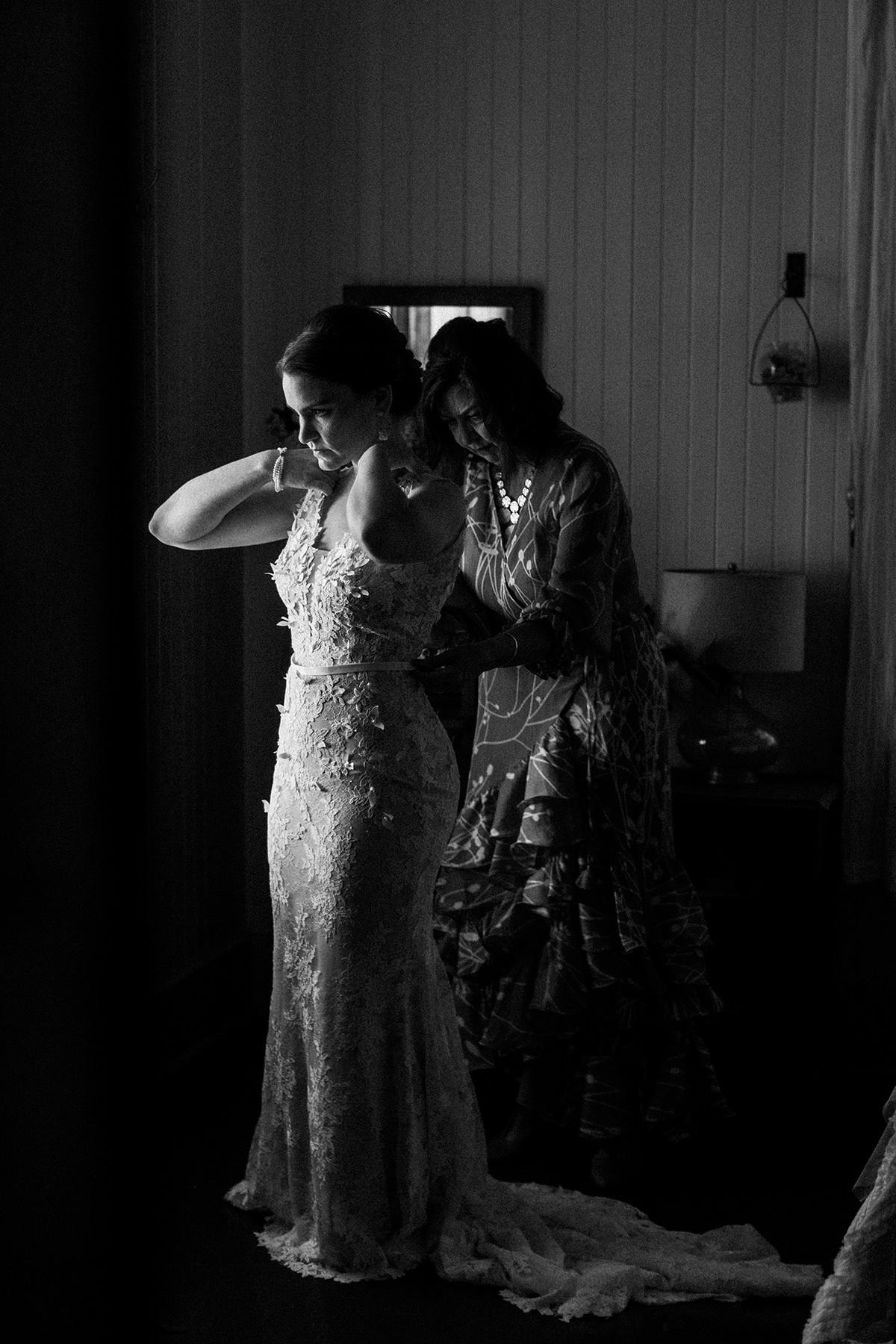 a bride gets dressed at Olowalu Plantation House Maui