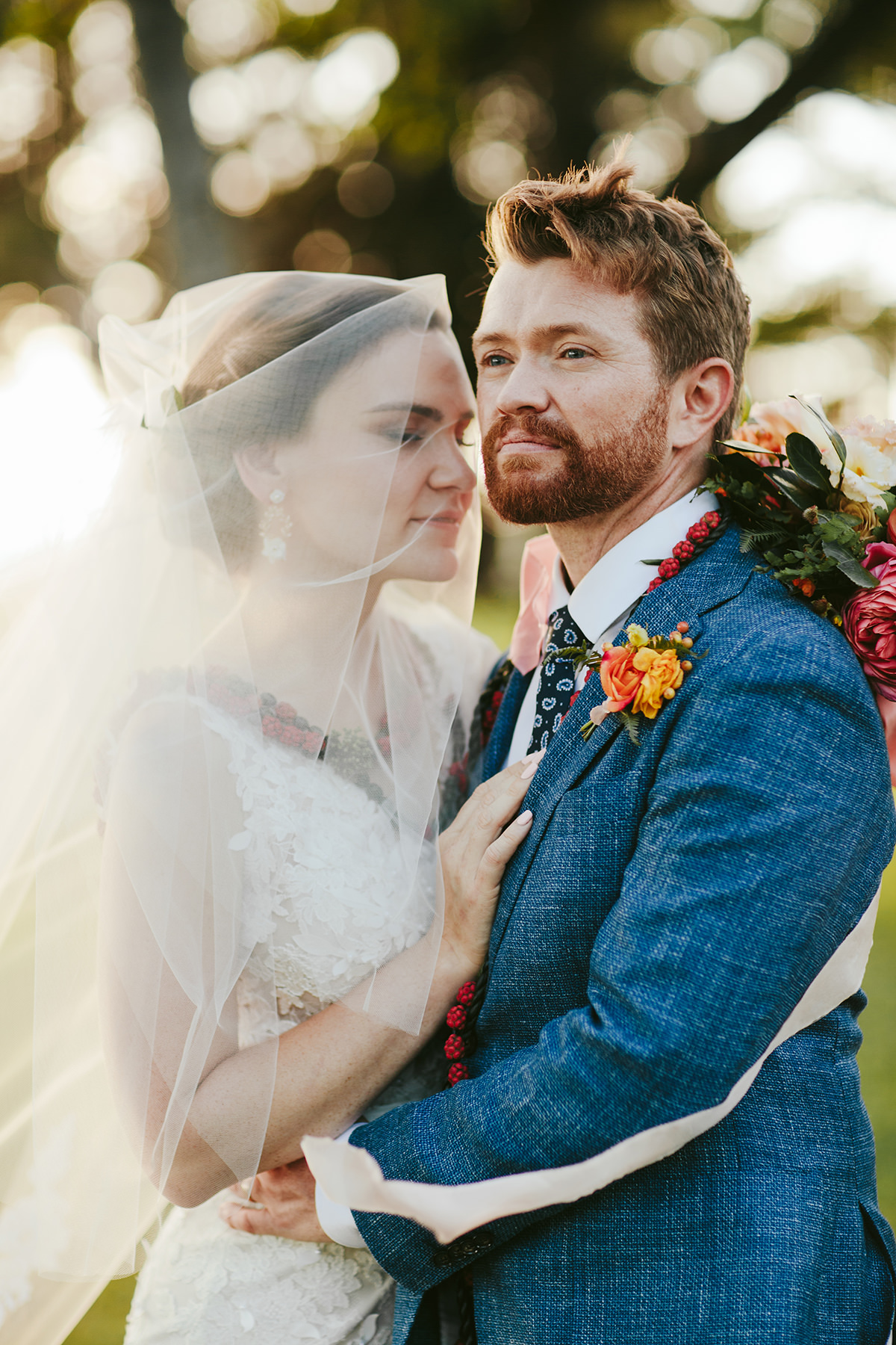 a veiled bride and her groom at their Maui wedding