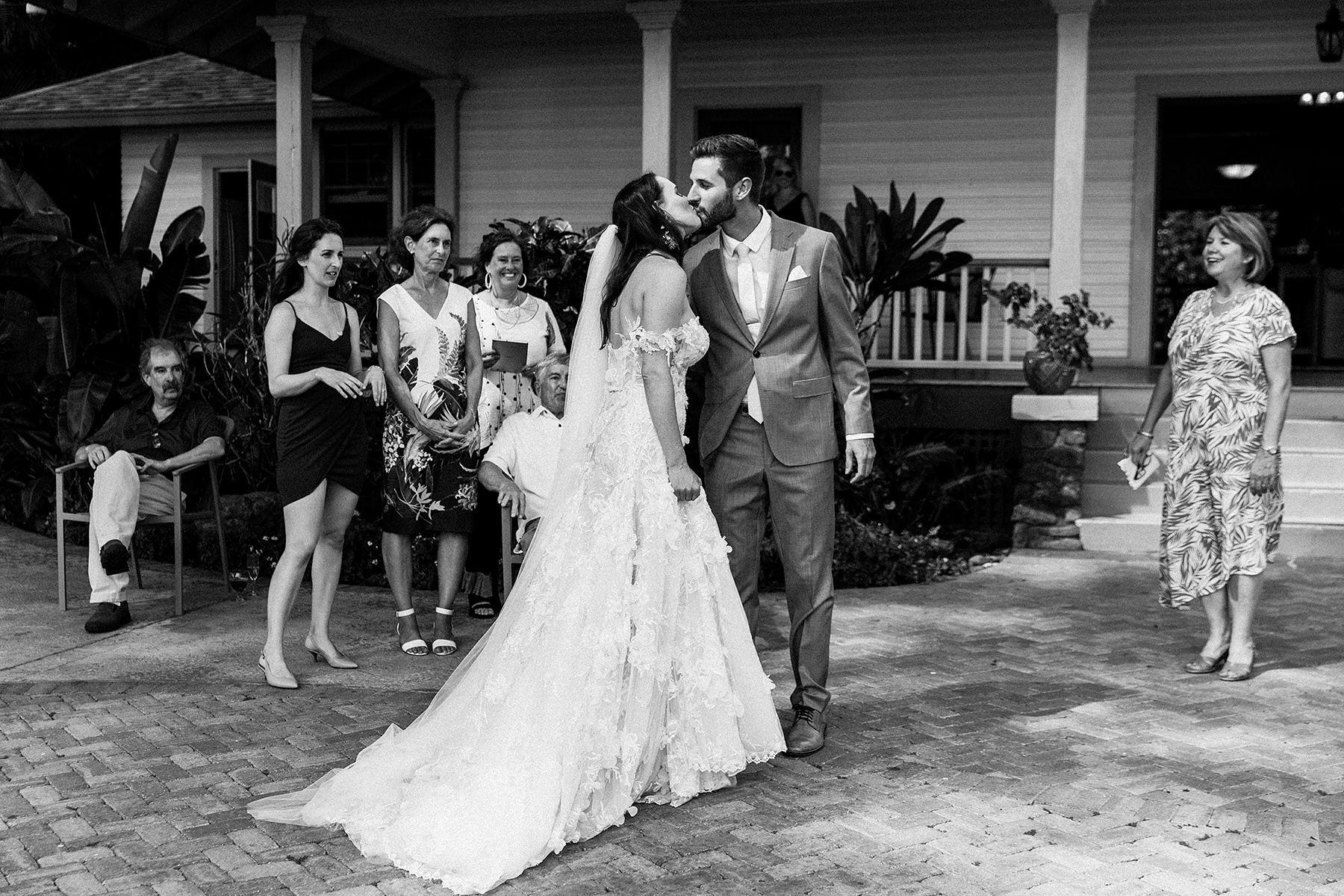 a bride and groom kiss at Olowalu Plantation House