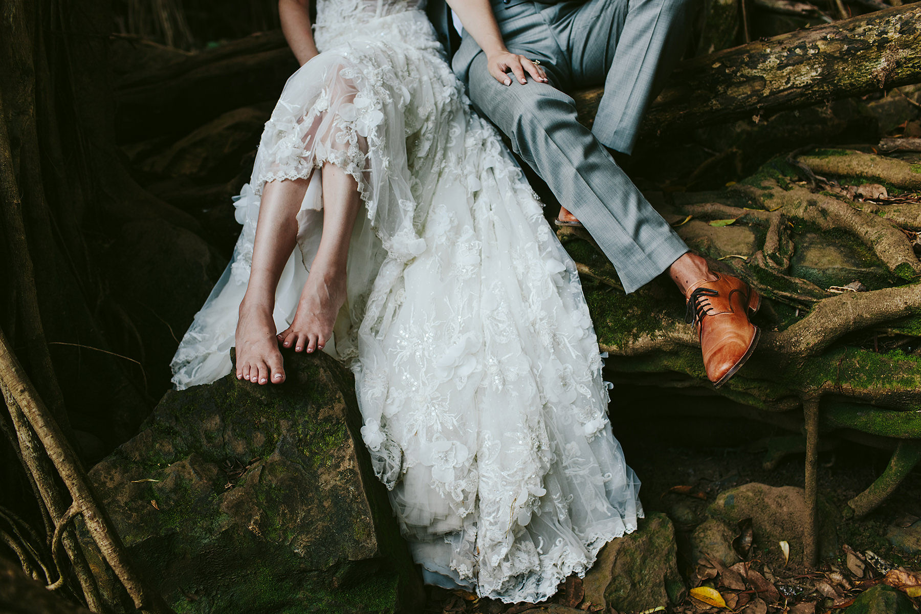detail of a bride and groom's feet in a banyan tree on Maui