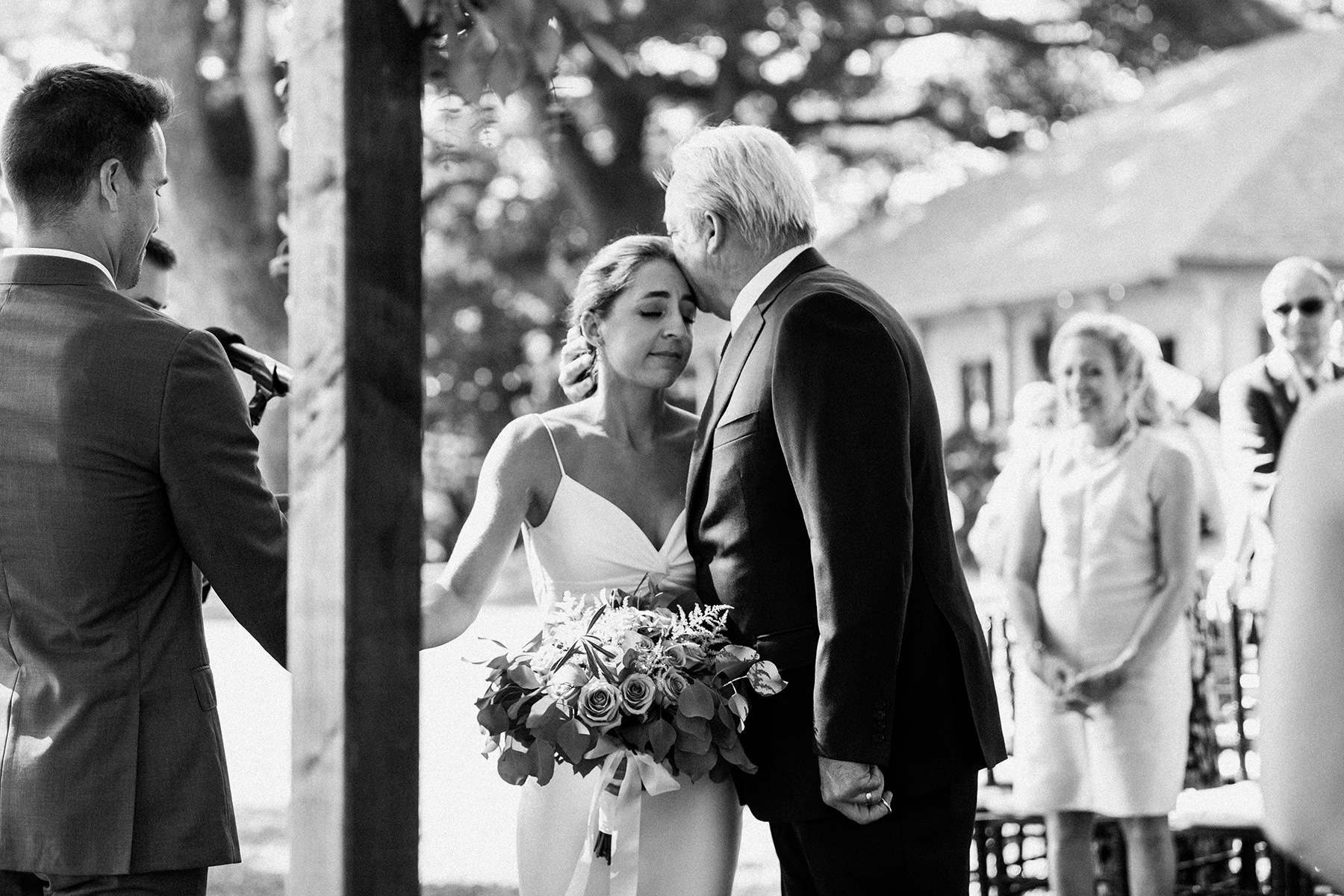 a father kisses his daughter, the bride, at Olowalu Plantation House