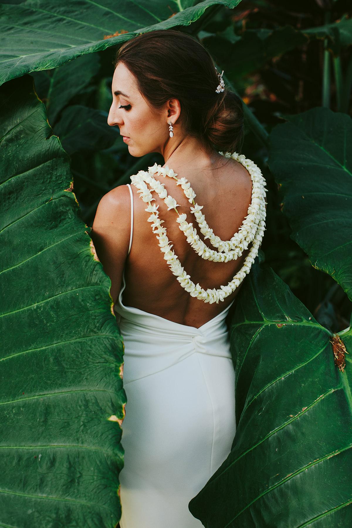 a bride wears a three strand pikake or jasmine lei at her Maui wedding