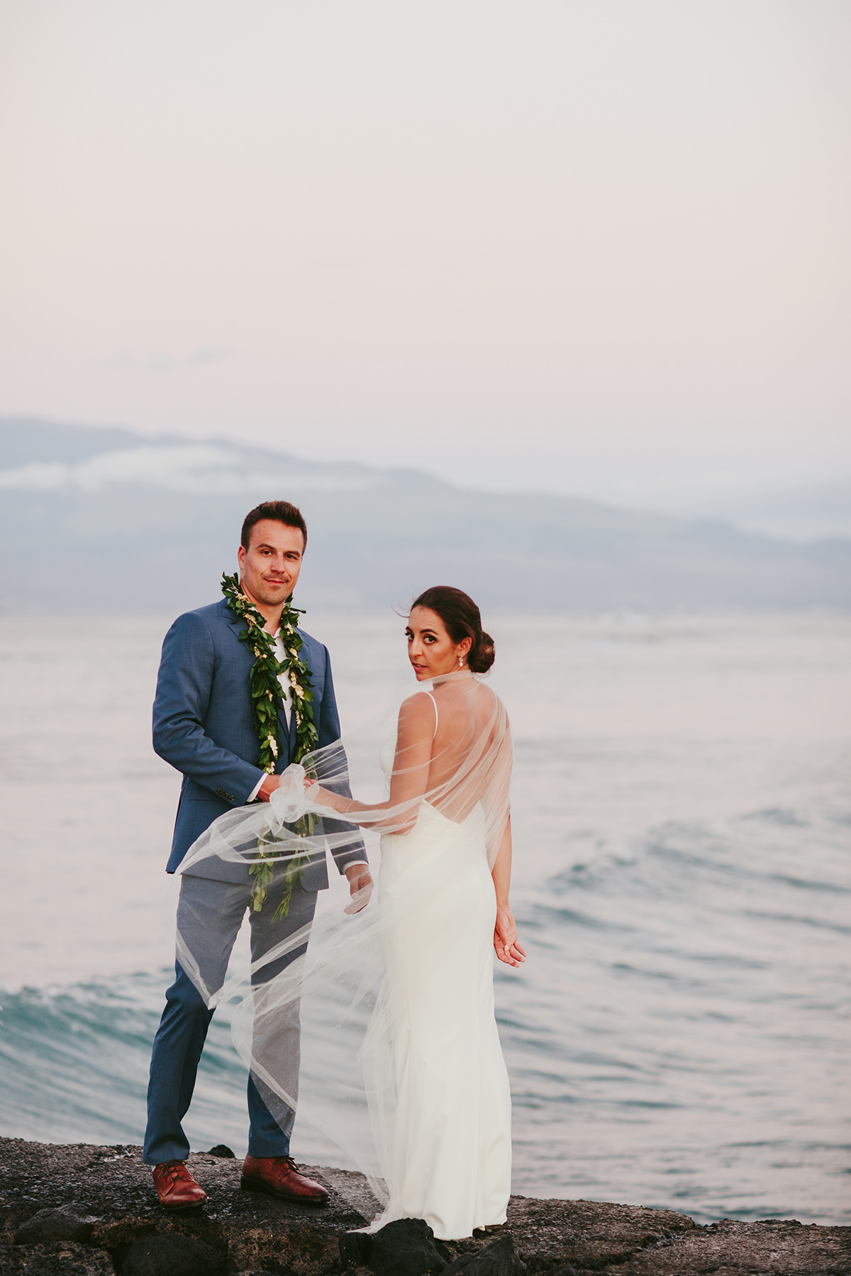 a bride and groom by the ocean in Maui
