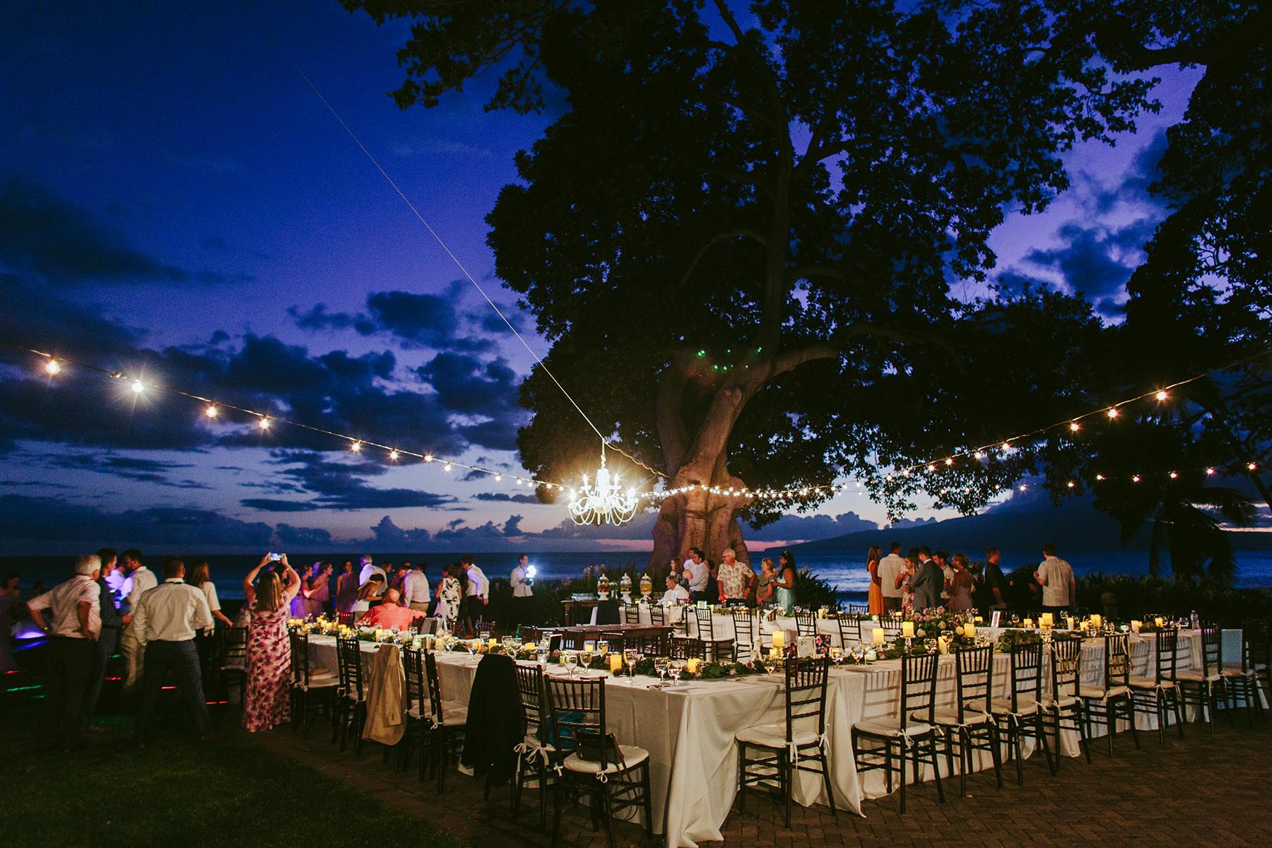 a dusk view of a wedding reception at Olowalu Plantation House