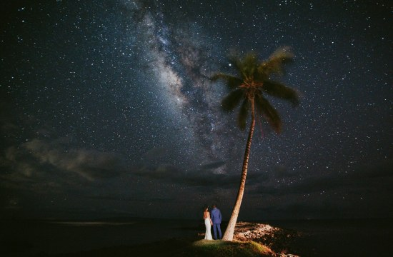 a bride and groom under the stars at their Maui wedding at Olowalu Plantation House