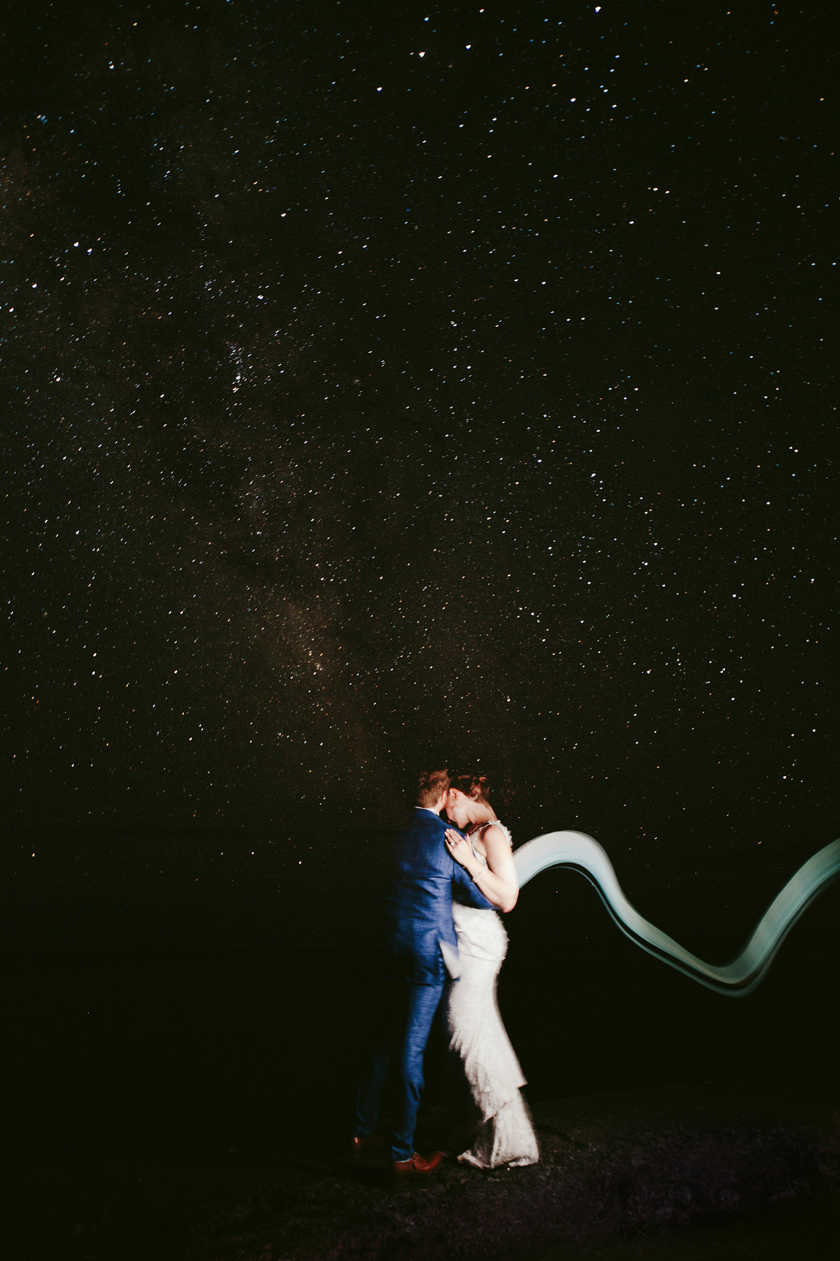 a bride and groom under a sky full of stars at their Maui wedding